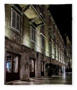 Up Lighting On A European Building At Night  Fleece Blanket