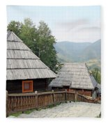 Village With Wooden Cabin Log On Mountain Fleece Blanket