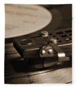 Vinyl Record Playing On A Turntable In Sepia Fleece Blanket