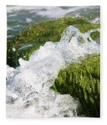 Wave Splash On The Green Rock Fleece Blanket