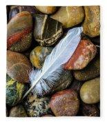 White Feather On River Stones Fleece Blanket