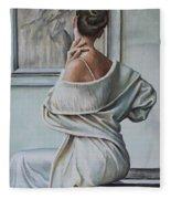 Woman Sat In A Gallery Fleece Blanket