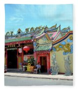 Woman Sits Outside Chinese Temple With Urn And Deity Statues Pattani Thailand Fleece Blanket