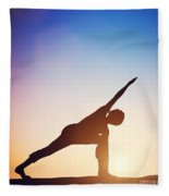Woman Standing In Revolved Side Angle Yoga Pose Meditating At Sunset Fleece Blanket