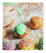 Woman's Hand Coating A Donut With Green Frosting. Fleece Blanket