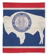 Wyoming Rustic Flag On Wood Fleece Blanket