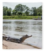 Yacare Caiman On Beach With Passing Boat Fleece Blanket