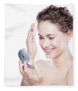 Young Beautiful Woman Applying Powder On Her Skin. Fleece Blanket