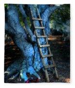 Young Woman Climbing A Tree Fleece Blanket
