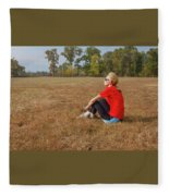 A Woman Is  Sitting In A Park And Admiring The Landscape Fleece Blanket