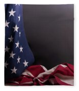 American Flag Draped On Itself Fleece Blanket by Vincent Billotto