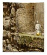 beer bottle left in old lane in Edinburgh Fleece Blanket