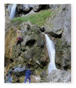 Climbers Making Their Way Up The Cliffs Of Gordale Scar Fleece Blanket