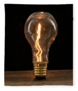 Fire Sparks Inside A Light Bulb Fleece Blanket by Vincent Billotto