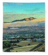 Fog Over Squaw Butte Fleece Blanket