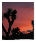 Joshua Trees Silhouetted Against A Red Sky Fleece Blanket