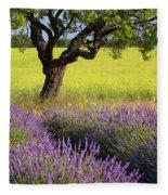 Lone Tree In Lavender And Mustard Fields Fleece Blanket by Brian Jannsen