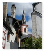 old historic church spire and houses in Ediger Germany Fleece Blanket