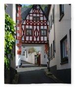 old historic street and woodframed house in Ediger Germany Fleece Blanket