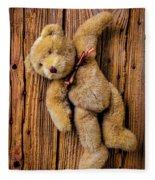 Old Teddy Bear Hanging On The Door Fleece Blanket