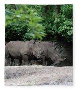 Pair Of Rhinos Standing In The Shade Of Trees Fleece Blanket