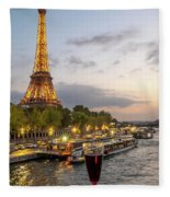 Portrait View Of The Eiffel Tower At Night With Wine Glass In The Foreground Fleece Blanket