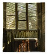 sunlight on linen fold altar in Trinity church York Fleece Blanket
