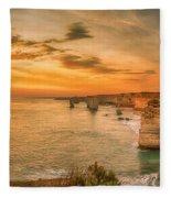 Sunset At The Twelve Apostles Fleece Blanket by Chris Cousins