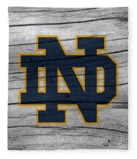 University Of Notre Dame Fighting Irish Logo On Rustic Wood Fleece Blanket