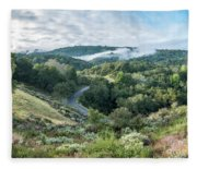 View Of Curved Road Through Dense Forest Area With Low Clouds Ov Fleece Blanket