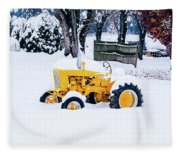 Yellow Tractor In The Snow Fleece Blanket