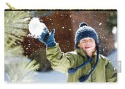 A Boy Throws A Snowball While Playing Carry-all Pouch