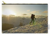A Man Backcountry Skiing At Sunset Carry-all Pouch
