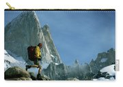 A Man Backpacks In Front Of Fitz Roy Carry-all Pouch