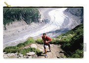 A Man Trail Runs In Chamonix, France Carry-all Pouch