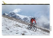 A Mountain Biker Rides Through The Snow Carry-all Pouch