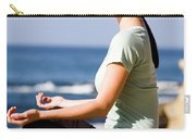 A Women Meditates On The Beach Carry-all Pouch