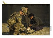 Airman Provides Medical Aid To A Local Carry-all Pouch