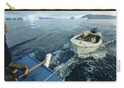 An Inuit Hunter Ferries His Sled Dogs Carry-all Pouch