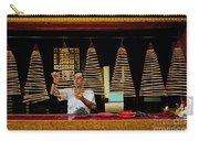 Man Lighting Incense In Chinese Temple Vietnam Carry-all Pouch