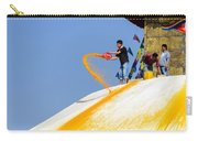 Man Throwing Orange Paint On Boudhanath Stupa Carry-all Pouch