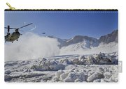 Snow Flies Up As A U.s. Army Ch-47 Carry-all Pouch