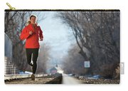 A Woman Running Near A Railroad Track Carry-all Pouch