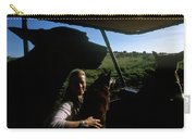 A Woman Sits In Her Safari Jeep Carry-all Pouch