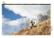 An Adult Male Trail Running Carry-all Pouch