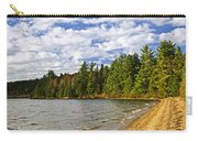 Red Canoe On Lake Shore Carry-all Pouch by Elena Elisseeva
