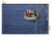 Sailors Lower A Rigid-hull Inflatable Carry-all Pouch