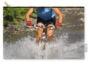 A Woman Mountain Bikes Along Trail 401 Carry-all Pouch