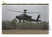 An Ah-64 Apache Helicopter In Midair Carry-all Pouch