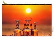 Sunset Behind A Restaurant Carry-all Pouch by George Atsametakis